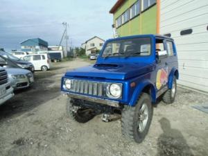 スズキ ジムニー ワイルドウインドリミテッド 4WD レッドブルカラー