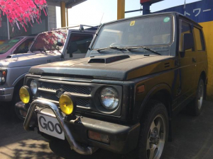 スズキ ジムニー ワイルドウインドリミテッド 4WD AC AW 背面タイヤ