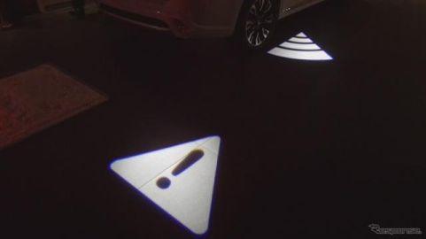 歩行者と光のアニメーションでコミュニケーションするクルマ…三菱電機が開発