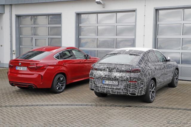 BMW X6 新型プロトタイプ(右)と現行型X6M《APOLLO NEWS SERVICE》