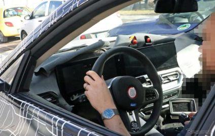 BMW初の4ドア電動クーペ『i4』、デビュー直前スクープ!コックピットを激写