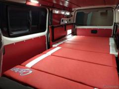 真っ赤な内装に球団ロゴ、カープ仕様のキャンピングカー発売…レクビィ