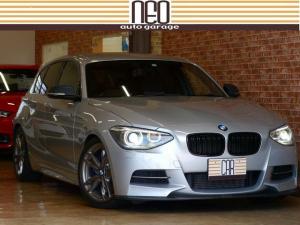 BMW 1シリーズ M135i カスタム装備100万以上 地デジチューナー 車高調  補強パーツ 3Dデザインエアロ スタディサブコン バックカメラ パドル Mパフォマフラー Mパフォブレーキ インテリアカーボンパーツ