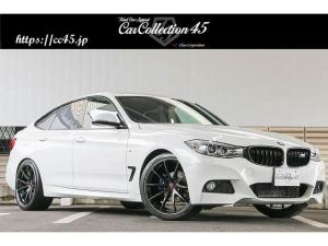 BMW 3シリーズ 320iグランツーリスモ Mスポーツ RAYS20インチホイール Mルックブルーペイントキャリパー ブラックキドニーグリル コンフォートアクセス パワーバックドア 衝突回避・被害軽減ブレーキ 社外地デジ インターフェイス装着 ETC