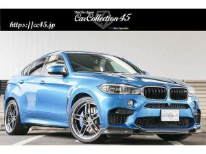BMW X6 M ベースグレード 正規ディーラー車 右ハンドル 3Dデザイン前後カーボンスポイラー ACシュニッツァー22AW LEDヘッド/フォグランプ サンルーフ インテリジェントセーフティー 全方位カメラ ブラウンレザーシート