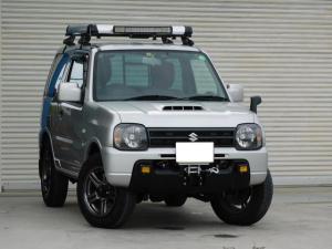 スズキ ジムニー XG ワンオーナー カスタマイズテールレンズ 追加ブーストメーター シートカバー フロントウインチ スノーブレード付属 ラゲッジキャリア 追加LEDライト数点 ロッソモデロリアマフラー 取締レーダー