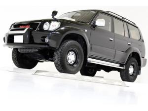トヨタ ランドクルーザープラド TXリミテッド 4WD 丸目仕様 ヴィンテージグリル ヴィンテージ16インチアルミホイール ブラックレザー調シートカバー ウッドコンビステアリング ナビ LEDイカリングヘッドライト LEDイカリングフォグランプ