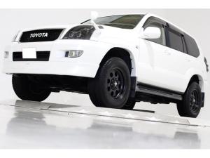 トヨタ ランドクルーザープラド TZ 4WD ハイトコントローラー付 新品ダッシュボード交換 フロントスポイラー ベージュレザー調シートカバー ウッドコンビステアリング ウッドコンビシフトノブ 社外16インチアルミホイール HDDナビ