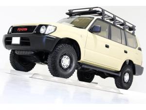 トヨタ ランドクルーザープラド TXリミテッド 4WD ナロー仕様 丸目仕様 ヴィンテージグリル ヴィンテージ16インチアルミホイール ルーフラック サンルーフ ベージュレザー調シートカバー LEDイカリングヘッドライト 3列シート 8人乗り