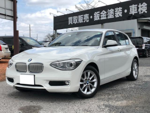 BMW 1シリーズ 116i スタイル HDDナビ アイドリングストップ スマートキー ETC ハーフレザーシート 盗難防止システム サイドエアバッグ 電動格納ミラー オートライト アルミホイール CD ABS ESC エアコン
