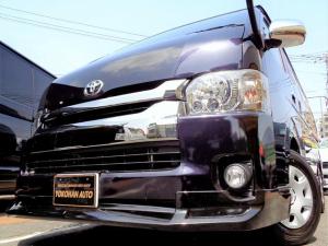 トヨタ ハイエースバン ロングワイドスーパーGL 5型ダークプライムII6AT1オーナー禁煙車SDフルセグバックカメラスマートキーエアロLEDライト専用レザー&黒木目インテリアWエアBAC100V