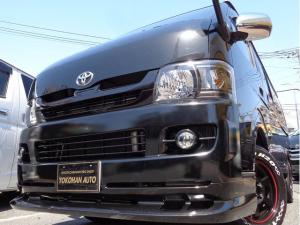 トヨタ ハイエースバン ロングスーパーGL 3.0DT4WD車内泊仕様ナビTV後席TVベット黒革調エアロBKインナーLED16AWH20WエアB
