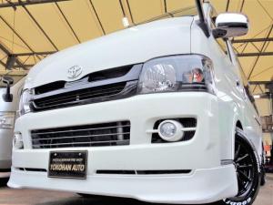 トヨタ ハイエースバン ロングスーパーGL 3.0DT1オーナーHDDフルセグセキュリティエアロBKインナーLED新品15AWナスカー黒革調AC100VTベル交換済