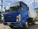 いすゞ/エルフトラック 3.25t積プレス式パッカー車6.0立米連続・汚水タンク付き