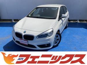 BMW 2シリーズ 218iアクティブツアラー 走行2.2万km・インテリジェントセーフティー・レーンアシスト・LEDヘッドライト・メーカーHDDナビ・音楽録音・ブルートゥース・USB接続・ミラー内蔵ETC・サイド&カーテン&ニーエアバッグ・禁煙車