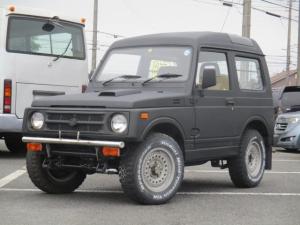 スズキ ジムニー EC 4WDターボ 社外AW フロントバンパー パノラミックルーフ 黒革調シートカバー