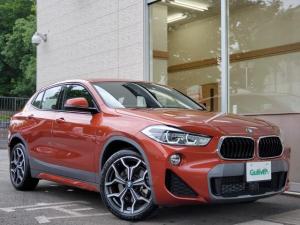 BMW X2 xDrive 20i MスポーツX  パノラマサンルーフ アドバンスドアクティブセーフティPKG パノラマサンルーフ アダプティブクルコン ヘッドライト パワーバックドア アイドリングストップ 19インチAW LEDライト シートヒーター サンセットオレンジ