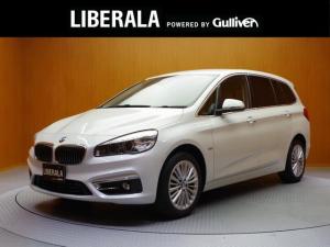 BMW 2シリーズ 218iグランツアラー ラグジュアリー インテリジェントセーフティ/茶革シート/前席Pシート/前シートヒーター/追従クルコン/HUD/パワーバックドア/Bカメラ/クリアランスソナー/コンフォートA/純正HDDナビ/新車時保証書/取説