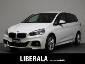 BMW 2シリーズ 218iグランツアラー Mスポーツ 1オーナー /アドバンスドアクティブセーフティPKG/ヘッドUPD/ACC/ETC/禁煙車/純正ナビ&バックカメラ/電動リアゲート/シートヒーター/純正17インチAW/コーナーセンサー/LEDライト