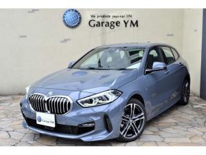BMW 1シリーズ 118i Mスポーツ DCT・オートマチックテールゲート・アクティブクルーズコントロール・HDDナビ・インテリジェントパーソナルアシスタント・アップルカープレイ・パーキングサポート・コンフォートアクセス・新車保証