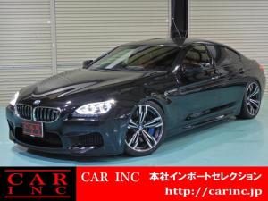 BMW M6 グランクーペ サキールオレンジメリノレザー ソフトクローズドア カーボンルーフ ヘッドアップディスプレイ インテリジェントセーフティ