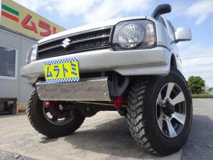 スズキ ジムニー XG 4WD オートマ 7型 ターボ リフトアップ 社外マフラー 16インチアルミマッドタイヤ 前後ハーフバンパー スキッドプレート ナンバー移設 ドラレコ HDDナビ 社外シート ETC 社外スピーカー