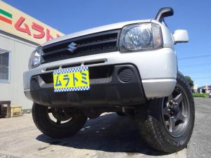 スズキ ジムニー XG 4WD ターボ 5MT車 8型 APIO足回りリフトアップ フジツボマフラー 社外16インチアルミホイール 背面タイヤ ステアリングダンパー 社外スピーカー キーレスキー ETC ルーフキャリア