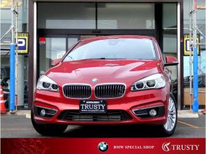 BMW 2シリーズ 218iグランツアラー ラグジュアリー パーキングサポートP 純正17AW ブラックレザー HDDナビ CD DVD MSV AUX USB ETC バックカメラ スマートキー LEDヘッドライト シートヒーター Dアシスト 1年保証