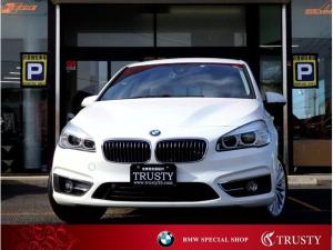 BMW 2シリーズ 218iグランツアラー ラグジュアリー パーキングサポートPKG ブラックレザー ドライビングアシスト HDDナビ MSV バックカメラ リアPDC スマートキー LEDヘッドライト シートヒーター メモリーPシート Pリアゲート 1年保証
