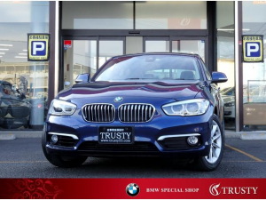 BMW 1シリーズ 118i スタイル ディーラー下取車 パーキングサポートPKG ドライビングアシスト クルコン 純正16AW ハーフレザー HDDナビ CD DVD バックカメラ リアPDC LEDヘッドライト 記録簿 取説 1年保証