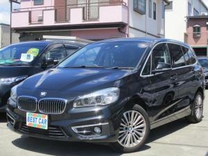 BMW 2シリーズ 218iグランツアラー ラグジュアリー 本革シート 純正ナビ バックカメラ ETC LEDヘッド Cセンサー 純正AW 電動シート シートヒーター新車記録簿