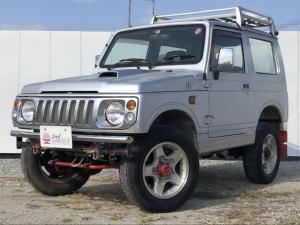 スズキ ジムニー XL 4WD 社外前後バンパー 社外グリル エアコン パワーステアリング CDオーディオ 1か月1,000Km保証付き 背面タイヤ