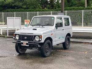 スズキ ジムニー ワイルドウインド 4WD ターボ車 タイミングチェーン 背面タイヤ 社外前後バンパー 社外マフラー CDデッキ 車検令和4年7月