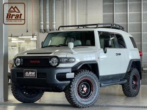 トヨタ FJクルーザー カラーパッケージ 4WD リフトアップ2インチ Bratセンターキャップ ルーフラック シートカバー SDナビ ヨコハマジオランダーM/T G003新品タイヤ リアデフロック A-TRAC 横滑防止 リアソナー ETC