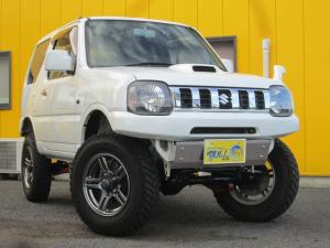 スズキ ジムニー XG 4WDマニュアル リフトアップ 新品社外前後バンパー 新品マッドタイヤ  新品社外マフラー ステンレススキッドプレート ナンバー移動キット 背面タイヤ移動キット 純正メッキグリル 純正16AW