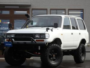 トヨタ ランドクルーザー80 西日本仕入GXパートタイム4WD5速マニュアルナルディステア BFグッドリッチマッドタイヤKM3ブラットレーホイールサファリシュノーケルロックスライダー新品LEDスモークテール角目4灯ヘッドライト切り替え4WD