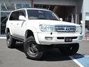 トヨタ/ランドクルーザー100 VXリミテッド 1NO登録 5人乗 リフトアップ・背面タイヤ
