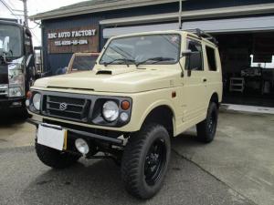 スズキ ジムニー ワイルドウインド 4WD 5速マニュアル リフトアップ 前後社外バンパー 背面タイヤ 純正16アルミ 記録簿