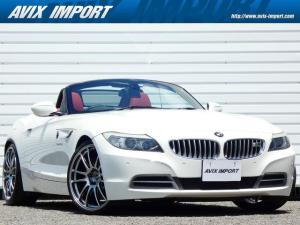BMW Z4 sDrive35i 右H 赤革 ナビ 地デジ PDC パワーシート ヒーター クルコン 電子シフト ダイナミックセレクト 電動オープン 社外カーボンステアリング エンケイ20インチAW キセノンヘッドライト