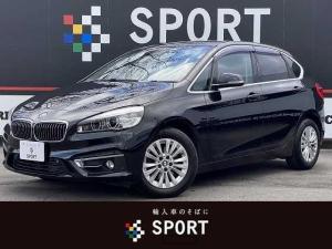 BMW 2シリーズ 218dアクティブツアラー ラグジュアリー インテリジェントセーフティ レザー コンフォートアクセス HDDナビ Bカメラ パワーシートメモリー シートヒーター DVD再生 ブルートゥース